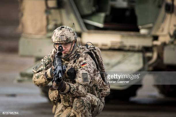 Soldier with equipment 'Infantryman of the Future Extended System and ready to fire gun Shot during an exercise of the land forces on October 13 2017...