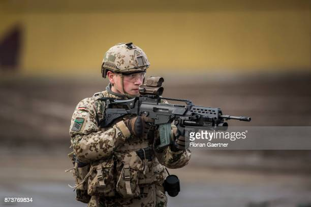 Soldier with equipment 'Infantryman of the Future - Extended System and ready to fire gun. Shot during an exercise of the land forces on October 13,...