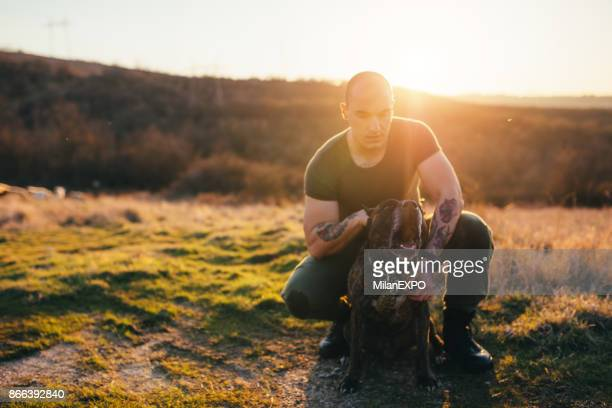 soldier with his pit bull terrier - french army stock pictures, royalty-free photos & images