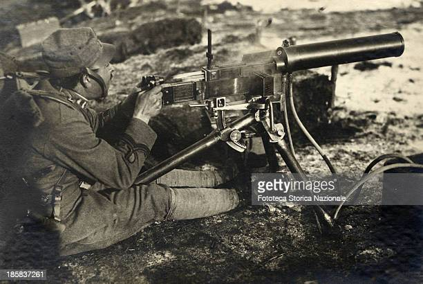 Soldier with machine gun FIAT model1914 the image illustrates how to use the new model of weapon Photography Scodogna Italy January 1918