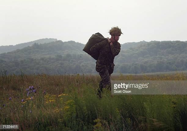 A soldier with the 3rd Battalion of the Royal Canadian Regiment out of Petawawa Ontario Canada walks from a landing zone after a parachute drop with...