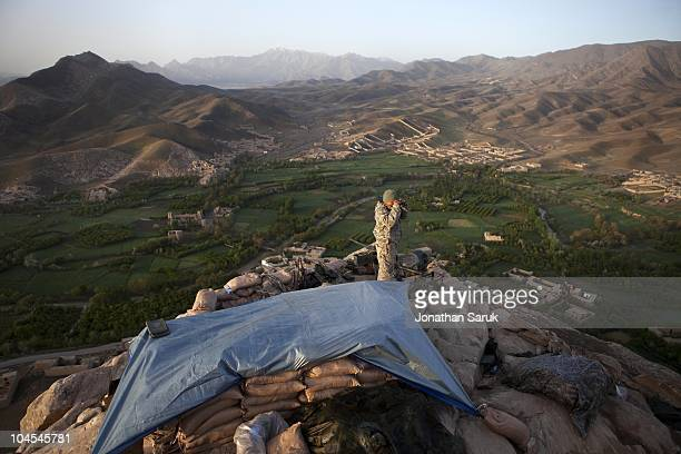 US soldier with the 3rd Brigade 10th Mountain Division mans an observation post May 7 2009 in the Tangi Valley Wardak Province Afghanistan The 10th...