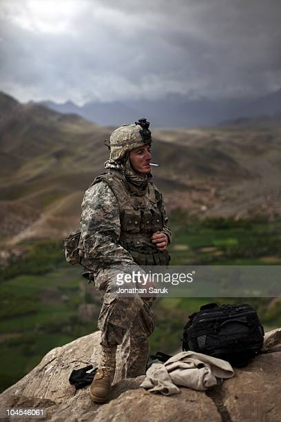 US soldier with the 3rd Brigade 10th Mountain Division smokes a cigarette in the early morning at an observation post May 4 2009 in the Tangi Valley...