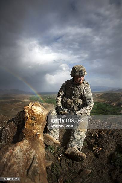 US soldier with the 3rd Brigade 10th Mountain Division takes a break while constructing an observation post at a new combat outpost May 3 2009 in the...