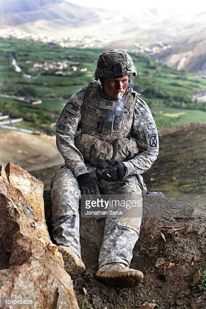 US soldier with the 3rd Brigade 10th Mountain Division takes a cigarette break while constructing an observation post at a new combat outpost May 3...
