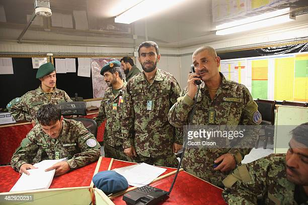 Soldier with the Afghan National Army direct security for the election from the tactical operations center at Camp Maiwand on April 5, 2014 near...