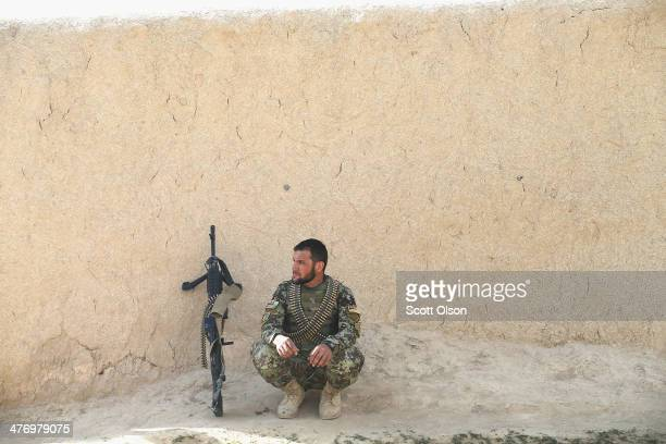 Soldier with the Afghan National Army keeps watch during a patrol through a village March 5, 2014 near Kandahar, Afghanistan. President Obama...