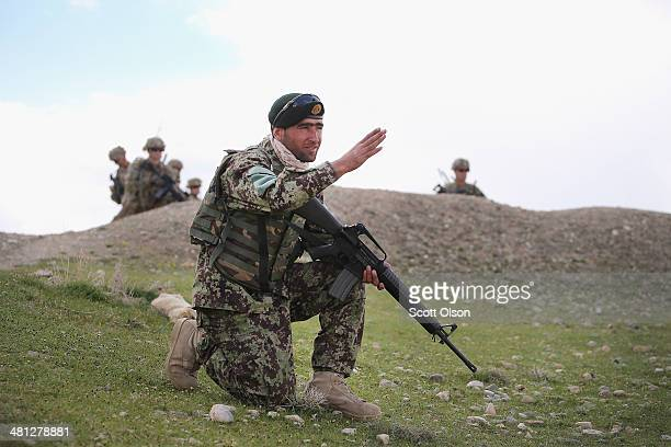 Soldier with the Afghan National Army patrols alongside soldiers with the U.S. Army's 2nd Battalion 87th Infantry Regiment, 3rd Brigade Combat Team,...