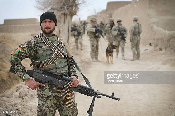 Soldier with the Afghan National Army patrols through a village with soldiers from the U.S. Army's 4th squadron 2d Cavalry Regimentsit on March 4,...