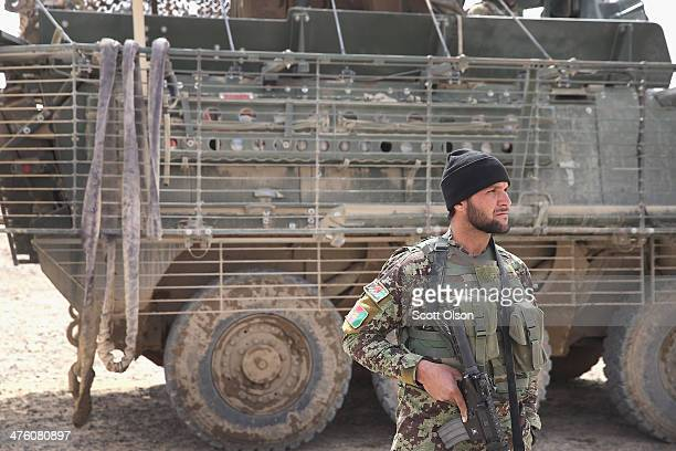 A soldier with the Afghan National Army prepares to patrol through a village with soldiers from the US Army's 4th squadron 2d Cavalry Regiment on...