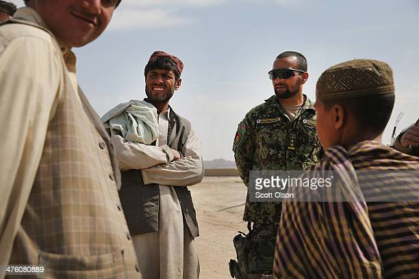 Soldier with the Afghan National Army questions villagers during a joint patrol with the U.S. Army's 4th squadron 2d Cavalry Regiment on March 2,...