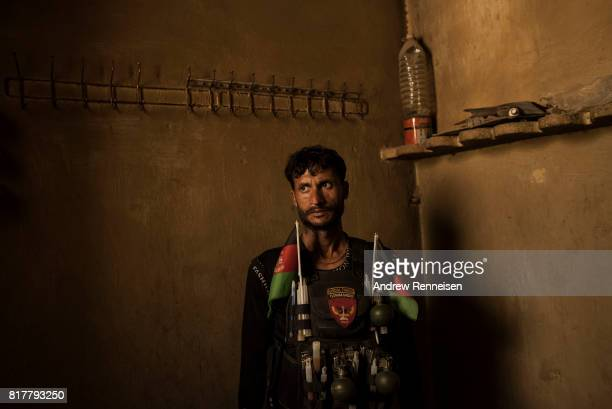 A soldier with the Afghan National Army stands in a room at an outpost in the Momand Valley on July 16 2017 in Achin District Afghanistan The...