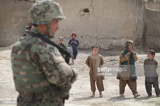 A soldier with the Afghan National Army walks through a village during a joint patrol with the US Army's 4th squadron 2d Cavalry Regiment on March 2...