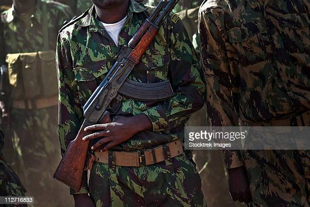 a soldier with the armed forces for the defense of mozambique - kalashnikov stock pictures, royalty-free photos & images