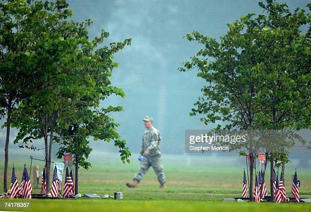 Soldier with the Army's 3rd Infantry Division walks along Warrior's Walk before a memorial tree dedication ceremony held for five soldiers who...