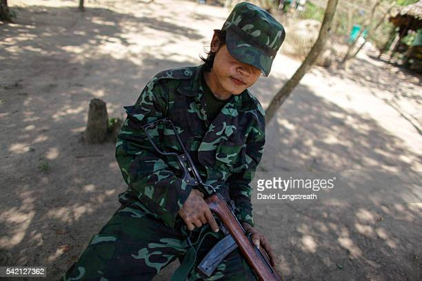 A soldier with the Karen Liberation Army hold his aging carbine as he looks on from a rebel camp The Karen have been fighting against the government...