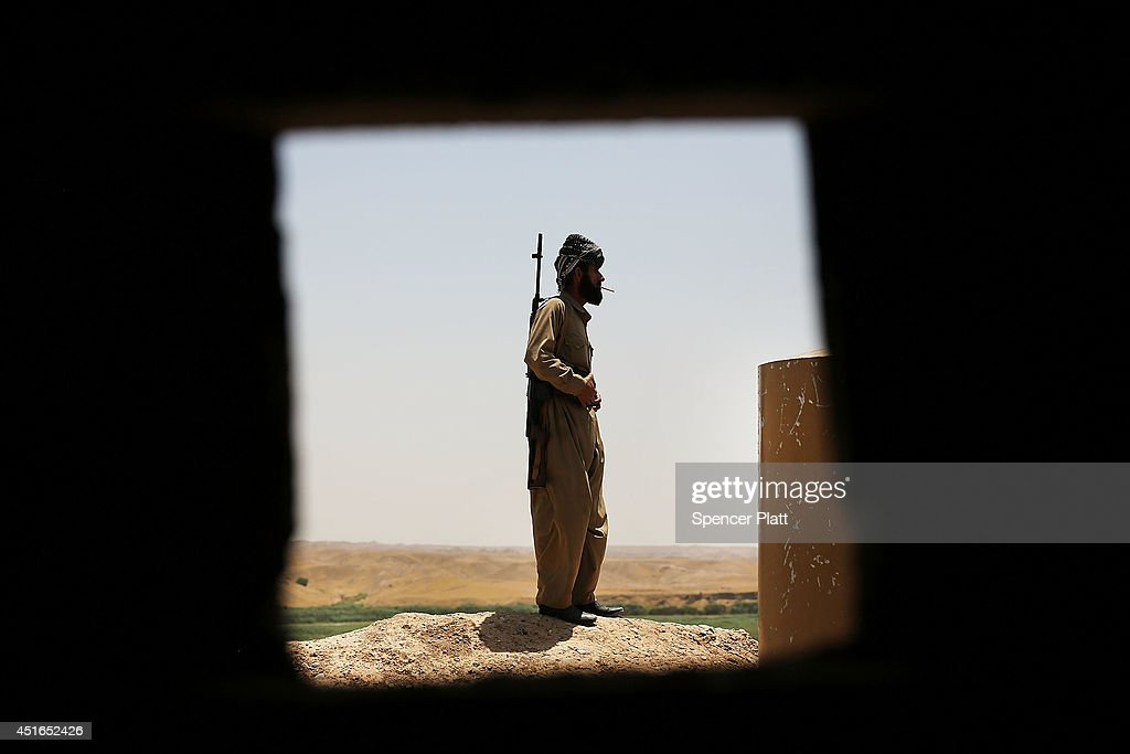 A soldier with the Kurdish peshmerga pauses at an outpost on the edges of the contested city of Kirkuk on July 3, 2014 in Kirkuk, Iraq. On Thursday the president of Iraq's autonomous Kurdish region, Massoud Barzani, asked Members of Parliament to start making plans for an independence referendum. American leaders and Iraqi Prime Minister Nouri al-Maliki's have urged the Kurds to back away from seeking independence.
