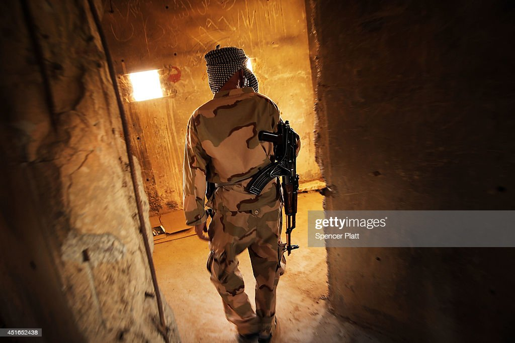 A soldier with the Kurdish peshmerga walks through a bunker at an outpost on the edges of the contested city of Kirkuk on July 3, 2014 in Kirkuk, Iraq. On Thursday the president of Iraq's autonomous Kurdish region, Massoud Barzani, asked Members of Parliament to start making plans for an independence referendum. American leaders and Iraqi Prime Minister Nouri al-Maliki's have urged the Kurds to back away from seeking independence.