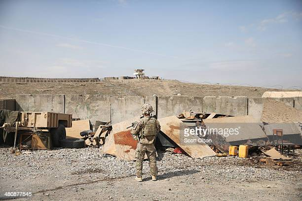 A soldier with the US Army 2nd Battalion 87th Infantry Regiment 3rd Brigade 10th Mountain Division provides security for Army advisers inside Forward...