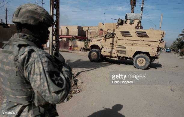 A soldier with the US Army's 212 infantry heads back to a new MRAP vehicle while on patrol November 17 2007 in Baghdad Iraq MRAPs are a family of...