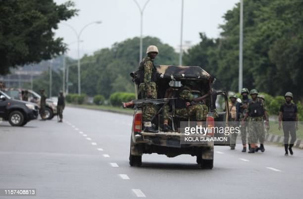 Soldiers aboard a truck patrol during a violent protest by Shiite Muslims demanding the release of their detained leader Ibrahim Zakzaky on July 23...