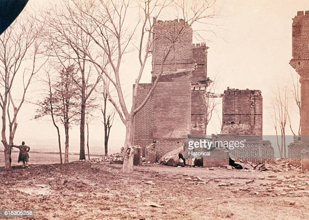 Soldiers admire the destruction wrought by the fighting around Fredericksburg Virginia during the American Civil War