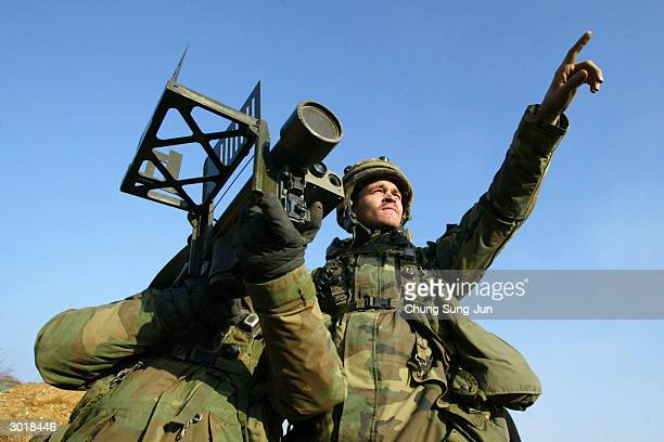 US soldiers aim a Stinger missile launcher during a military exercise on February 27 2004 in Yeonchun South Korea The yearly exercise called 'Iron...