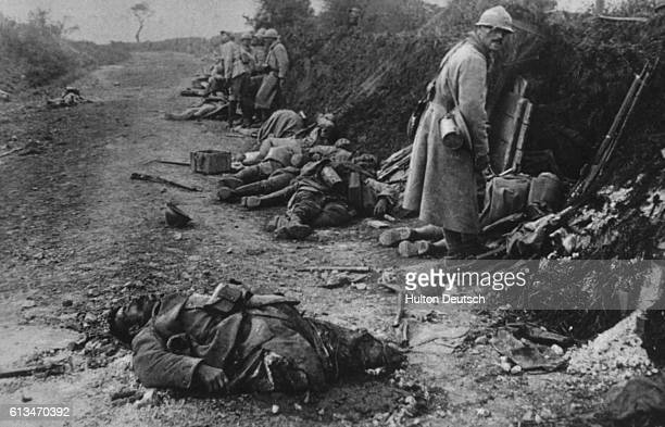 Soldiers among dead and maimed corpses during World War I