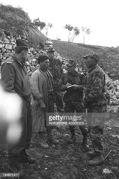 Soldiers and a civilian during the 'Operation Bigeard' in March 1956 when an armed outbreak in SoukAhras South of Constantine region Algeria led to...