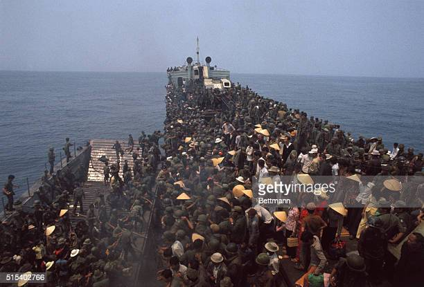 Soldiers and civilians are jammed together on a Navy boat that evacuated them from the old imperial capital of Hue.