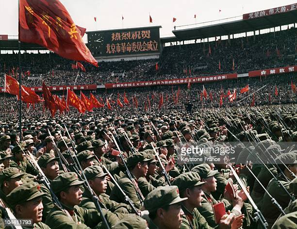Soldiers and civilians gathered to celebrate the establishment of the revolutionary committee of Beijing's garrison at the great stadium of Beiijng...