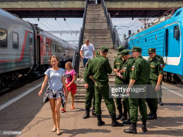 Soldiers and civilians mix during a station stop on the TransSiberian Railway from MoscowVladivostok Spanning a length of 9289km it's the longest...