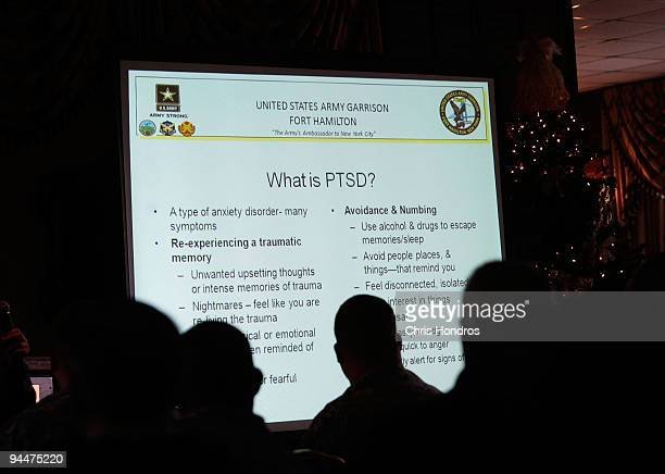 Soldiers and civilians watch a presentation about Post Traumatic Stress Disorder December 15 2009 at Fort Hamilton Army Garrison in Brooklyn New York...