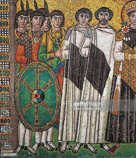 Soldiers and dignitaries detail from Emperor Justinian and his entourage mosaic northern wall of the apse Basilica of San Vitale Ravenna...