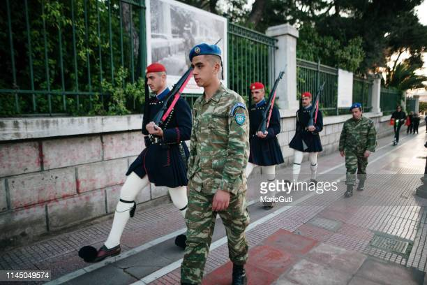Soldiers and Evzones walking near Syntagma Palace in Athens