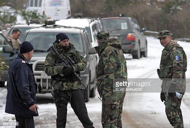 US soldiers and Italian carabinieri all members of of a NATO mission and EU peacekeepers in Bosnia search the vicinity of the village of Kalovita...