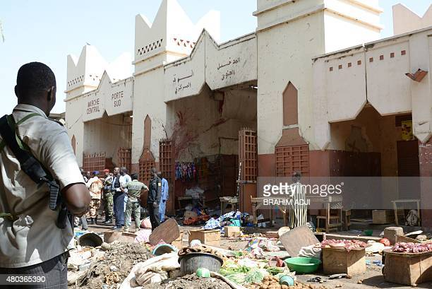Soldiers and police forces stand guard at a market in N'Djamena following a suicide bomb attack on July 11 2015 At least 14 people were killed in a...