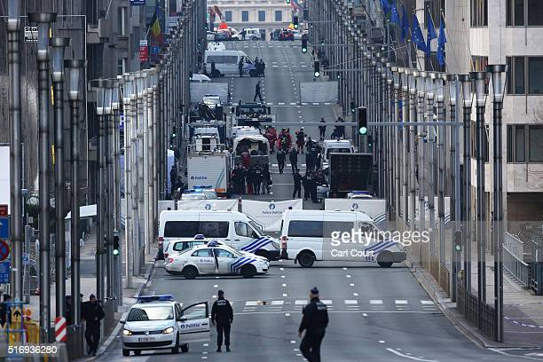 Soldiers and police officers patrol outside Maelbeek metro station following todays attack on March 22 2016 in Brussels Belgium At least 31 people...