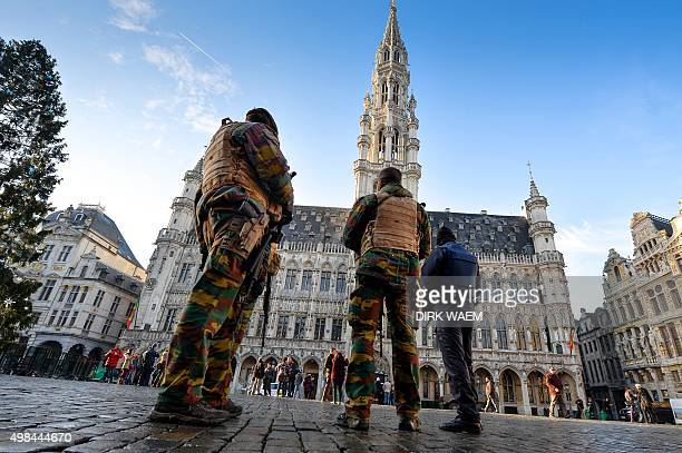 Soldiers and police patrol on Brussels' Grand Place as the Belgian capital remains on the highest possible alert level on November 23 2015 Belgian...