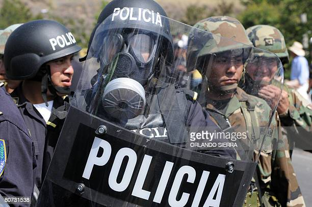 Soldiers and policemen are deployed next to a blockade carried out by union members to protest against the high cost of living particularly the...