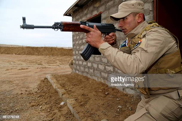 Soldiers and policemen get training within the liberation of Mosul plan at Doberdan Camp in Berderesh district of Dohuk Iraq on January 10 2015 They...