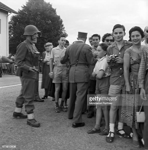 'Soldiers and policemen sending away a crowd of curious people during the Geneva Summit discussing issues about security German reunification and...
