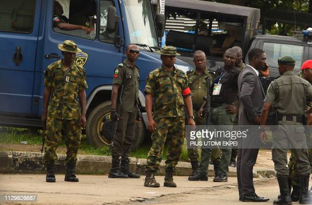 Soldiers and policemen stand at the gate of the state headquarters of Independent National Electoral Commission in Port Harcourt Rivers State on...