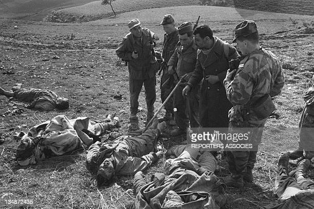 "Soldiers and prisoners and dead bodies during the ""Operation Bigeard"" in March 1956, when an armed outbreak in Souk-Ahras, South of Constantine..."