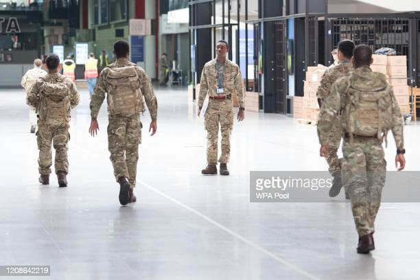 Soldiers and private contractors help to prepare the ExCel centre which is being made into the temporary NHS Nightingale hospital, comprising of two...