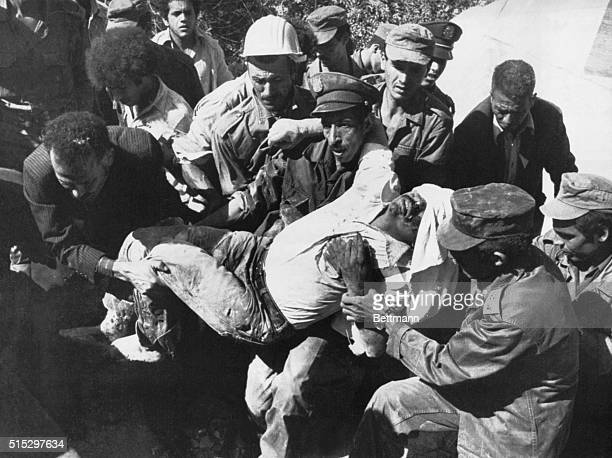 Soldiers and rescue workers carry an injured earthquake victim from the 1980 El Asnam earthquake | Location ElAsnam Algeria