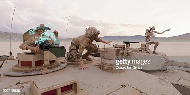 Soldiers and robot on tank wearing virtual reality goggles