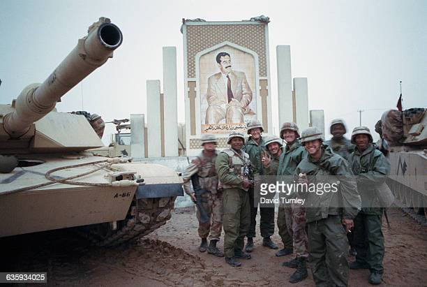 Soldiers and Saddam Hussein Mural