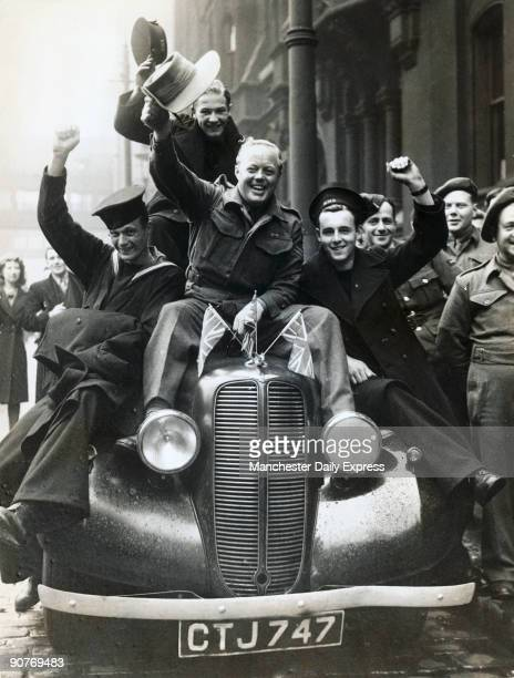 Soldiers and sailors on leave join in the VE Day celebrations at Albert Square British World War Two servicemen celebrate Victory in Europe The...