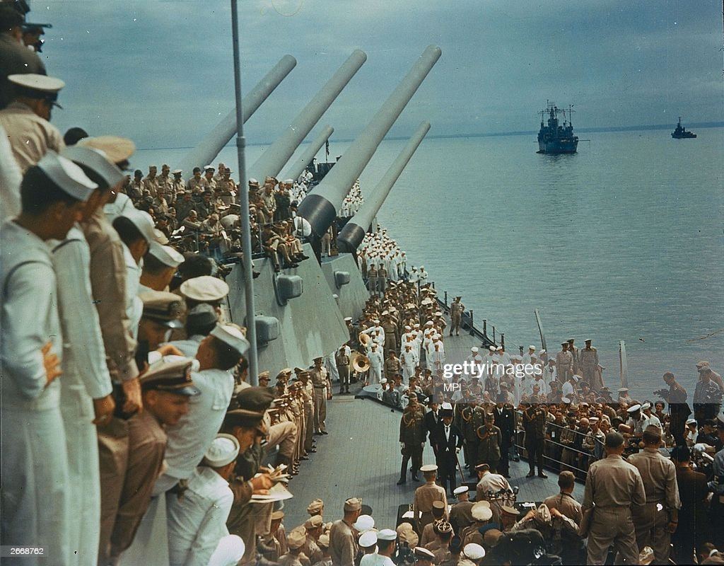Soldiers and sailors on the decks of the USS Missouri to watch the Japanese surrender which was signed on board, 2nd September 1945.